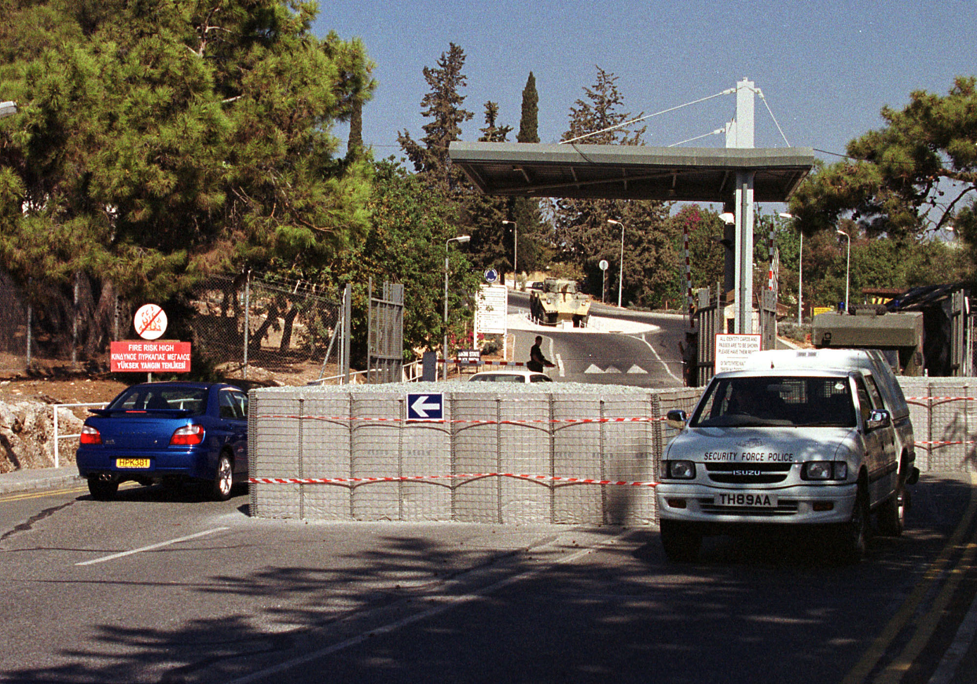 Steel cages full of gravel stand in front of the main entrance to the British Army base of Episkopi, Cyprus on Wednesday, October 10, 2001. Security on and around the base has been increased since the begining   attacks in Afghanistan.  (AP Photo/Philip Mark)